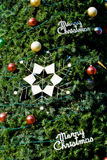 Balls and star decoration in Christmas tree Royalty Free Stock Photo
