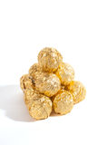 Balls of sweets in golden sweetie paper Royalty Free Stock Photo