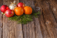 Balls with tangerines on rustic tabel. Christmas decoration idea. Balls with tangerines on rustic tabel Stock Images