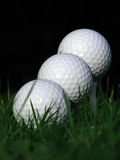Balls on the tee. Detail of three golf balls Stock Images