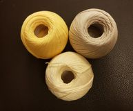 balls of thin yarn for knitting in yellow and brown Stock Image