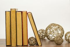 Balls of thread are next to the books. royalty free stock photos