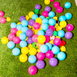 Balls and toys on the grass. Stock Photos