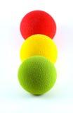 Balls in a Traffic Light Arrangement. Foam balls lined up in a traffic light metaphor stock photos