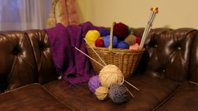 Balls of varicoloured threads in a basket for needlework. stock video