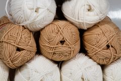 Balls of white and beige wool abstract background Royalty Free Stock Image