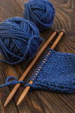 Balls of wool blue colors and knitting on wooden needles Stock Photo