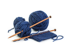 Balls of wool blue colors and knitting on wooden needles Stock Photography