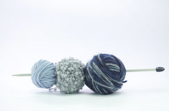 Balls of wool on the blue shades in different yarns. Isolated on white Royalty Free Stock Photo