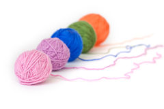 Balls of wool of different colors Royalty Free Stock Photography