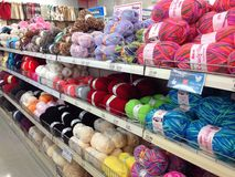 Balls of wool or yarn for knitting. Different coloured balls of wool or yarn on display on shelves for knitting and hobbies stock image