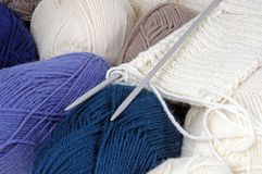 Balls of wool and knitting. Royalty Free Stock Photography