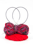Balls of wool with a knitting needle Royalty Free Stock Images