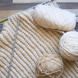 Balls of wool and knitting on a wooden table. View from above. Stock Photography