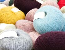 Balls of wool on display royalty free stock image