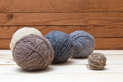Balls of wool on wooden background Stock Photography