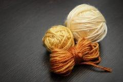 The balls of woolen threads. Stock Photos
