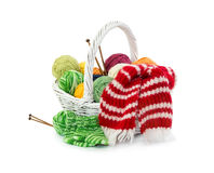 Balls of woolen threads in wicker basket Royalty Free Stock Images