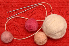 Balls of woollen threads and knitting needle Stock Photography