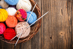 Balls of yarn. In a basket with knitting needles stock photography