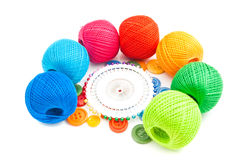 Balls of yarn, colored pins and buttons Stock Images