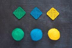 Balls of yarn and crocheted motives Royalty Free Stock Image