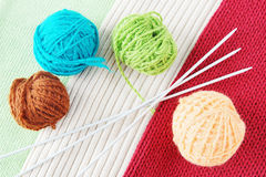 Balls of yarn on knitted fabrics Stock Image