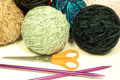 Balls of Yarn and Knitting Needles. This is a close up image of balls of yarn, knitting needles, and scissors stock images