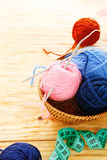 Balls of yarn and knitting needles Royalty Free Stock Photography