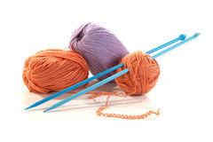 Balls of a yarn knitting spokes Royalty Free Stock Image