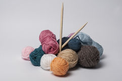 Balls of yarn for knitting with the wooden needles Royalty Free Stock Photos