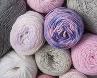 Balls of yarn. In pink, purple and grey Royalty Free Stock Photo