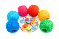 Balls of yarn, pins and plastic buttons Stock Image