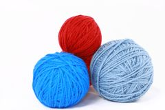 Balls Of Yarn In Red And Blues Stock Images