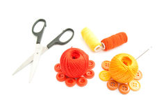 Balls of yarn, scissors and buttons on white Royalty Free Stock Photos