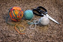 Balls of Yarn and Scissors for Crafts Stock Images