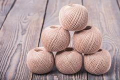 Balls of yarn thread for knitting on a wooden background stock photos