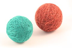 Balls of yarn. Two green and red balls of yarn on white Royalty Free Stock Image