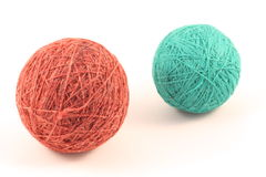 Balls of yarn. Two green and red balls of yarn on white Stock Photos