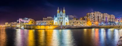 Balluta bay, Malta - Panoramic view of the famous Church of Our Lady of Mount Carmel at Balluta bay. By night Royalty Free Stock Photos
