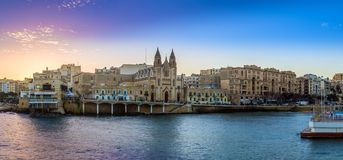Balluta bay, Malta - Panoramic view of the famous Church of Our Lady of Mount Carmel at Balluta bay. At sunrise Stock Photo