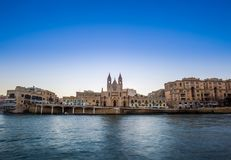 Balluta bay, Malta - Panoramic view of the famous Church of Our Lady of Mount Carmel at Balluta bay. At sunrise Stock Image