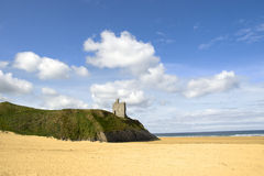 Ballybunion castle on the edge of a cliff. Overhanging a beautiful beach in county Kerry Ireland Stock Image