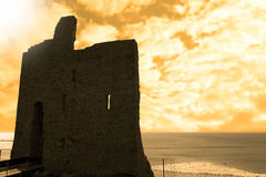 Ballybunion castle at sunset. Close up of old castle in Ballybunion county Kerry Ireland at sunset with surfers in background Royalty Free Stock Photo