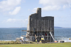 Ballybunion castle surrounded by scafolding. While under repair Stock Photos