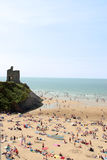 Ballybunion hot sand. Ballybunion beach crowded with people on a hot day with castle Royalty Free Stock Image