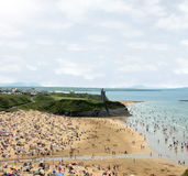 Ballybunion hot sands. Ballybunion beach crowded with people on a hot day with castle Stock Photography