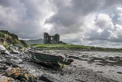 Ballycarbery Castle with old boat stock image