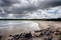 Ballycastle Beach on the Causeway Coast Route Northern Ireland. Ballycastle, Ireland – JUN 14 2018: Ballycastle beach is a popular tourist destination royalty free stock images