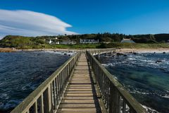 Landscape wooden bridge at Ballycastle beach, Northern Ireland. Ballycastle Beach is a popular tourist destination located on the Causeway Coastal Route on the stock images